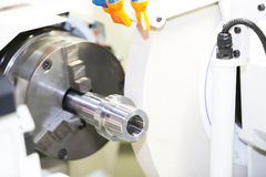 Operator grinding mold and die part Royalty Free Stock Image