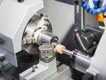 Operator grinding mold and die part. By universal grining machine stock photography