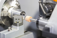 Operator grinding mold and die part Stock Photos