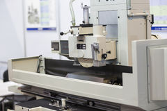 Operator grinding surface of mold and die parts Stock Image