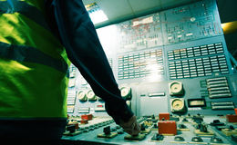 Operator hand on the control panel power plant Royalty Free Stock Photos