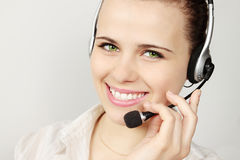 Operator in headset. Support phone operator in headset on gray Stock Photo