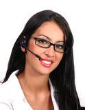 Operator with headset and glasses (Latin). Happy latin operator with headset and glasses Royalty Free Stock Photo