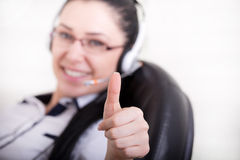 Operator with headset showing ok sign Royalty Free Stock Images