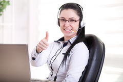 Operator with headset showing ok sign Stock Photography