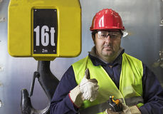 Operator and hook of construction crane Stock Photography