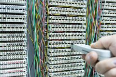 Operator installing telephone switchboard with  cables Royalty Free Stock Photos
