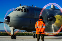 An operator of the Italian air , in front of the airplane  Atlantic. Italian air force attemp for surveillance operations in the Mediterranean Sea; to control Royalty Free Stock Photos