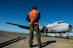 An operator of the Italian air , in front of the airplane. Italian air force attemp for surveillance operations in the Mediterranean Sea; to control migration Royalty Free Stock Images