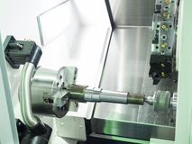 Operator machining automotive part Royalty Free Stock Photo