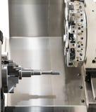 Operator machining automotive part by cnc turning machine. Machining automotive part by cnc turning machine, Multi axis CNC turning and milling machine, High stock photo