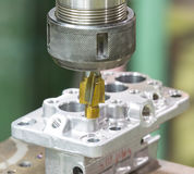 Operator machining automotive parts by machining center Stock Photography