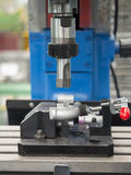 Operator machining automotive parts by machining center Royalty Free Stock Images