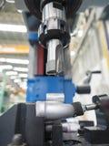 Operator machining automotive parts by machining center Stock Photo