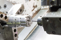Operator machining die casting machine parts Stock Images