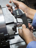 Operator machining mold and die part by CNC turning machine in f. Actory royalty free stock photos