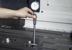 Operator measuring Stock Photography