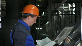 Operator monitors control panel of production line. Manufacture of plastic water pipes factory. Process of making. Operator monitors control panel of production royalty free stock images
