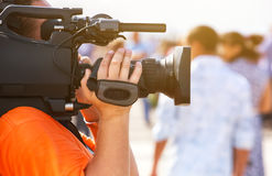 The operator photographer takes on a professional camera interviews. In the mass celebration stock photography