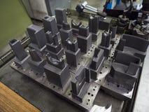 Operator prepare EDM electrod of precision mold and die. Operator prepare graphite EDM electrod of precision mold and die stock images