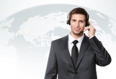 Operator puts earphones with mic Stock Photography