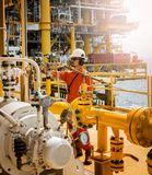 Operator recording operation of oil and gas process at oil and r stock image