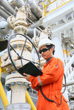 Operator recording operation of oil and gas process at oil and rig plant, offshore oil and gas industry, offshore oil and rig. In the sea, operator monitor Stock Images