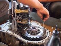 Operator repair gear box Stock Images