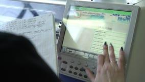 Operator setting knitting machine programme view stock video footage