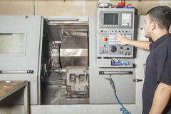 Operator setup cnc turning machine Royalty Free Stock Photo