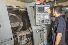 Operator setup cnc turning machine Stock Photo