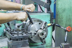 Operator setup turning part on manual lathe machine Royalty Free Stock Photos