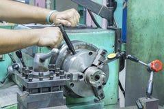 Operator setup turning part on manual lathe machine. By dial gauge royalty free stock photos