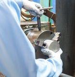Operator setup turning part on manual lathe machine Stock Photography