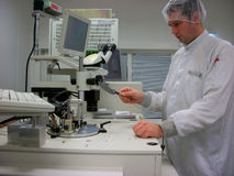 The operator with the silicon wafer Stock Image