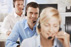 Operator talking on headset. Young customer service operator talking on headset, smiling royalty free stock images