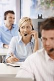 Operator talking on headset. Young customer service operator talking on headset, smiling Stock Photography
