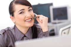 Operator talking on headset Royalty Free Stock Images