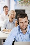 Operator talking on headset. Young customer service operator talking on headset, smiling Stock Images