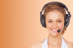 Operator of technical support service. Isolated on orange background Royalty Free Stock Photography