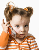 Operator is on telephone. Little girl is operating on the telephone Royalty Free Stock Photography