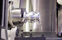 Operator turning aluminium autopart by cnc lathe Stock Photography
