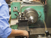 Operator turning mold parts by manual lathe Stock Photo