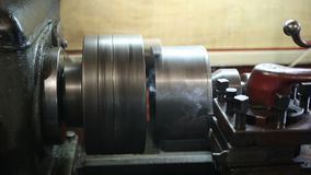 Operator turning part by manual lathe machine stock video footage