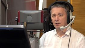 Operator on TV. The operator works with a cinema TV broadcast camera stock footage