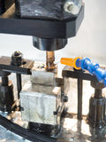 Operator use EDM electrod to make precision mold and die. Operator use graphite EDM electrod to make precision mold and die royalty free stock photography
