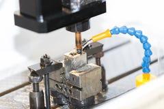 Operator use EDM electrod to make precision mold and die. Operator use graphite EDM electrod to make precision mold and die stock photography