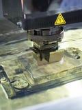 Operator use EDM electrod to make precision mold and die. Operator use graphite EDM electrod to make precision mold and die royalty free stock images