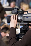 Operator with video camera. Shooting some event Royalty Free Stock Image