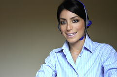Operator woman in phone. Glad woman operator working talking in phone royalty free stock image